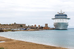 Big white cruise ship in port of the island  Rhodes Greece Royalty Free Stock Photo