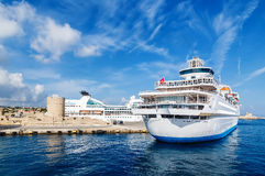 Big white cruise ship in the port of the island  Rhodes Greece Stock Photos