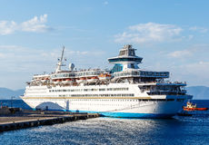 Big white cruise ship in the port of the island  Rhodes Greece Stock Image