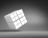 Big White Cube of Small Cubes on Gray Background Royalty Free Stock Images