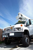 Big white diesel truck with boom