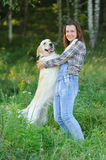 Big white dog put paws on the shoulders of its owner Royalty Free Stock Photos