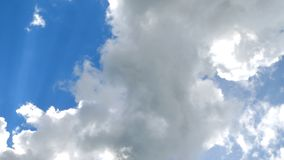 Big white dramatic fluffy clouds in the blue sky on sunny light. Abstract nature background stock footage