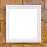Big white frame. On brick wall Stock Images