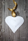 Big white heart on wooden background Royalty Free Stock Photos