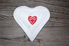Big white heart on wooden background Stock Image