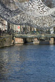 Big white lace fabric over the canal. In Amsterdam Stock Photography