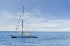 Big white luxury yach docked at sea but ready to travel any time. To tropical beautiful water stock photos