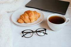 Coffee and croissant in bed stock photos