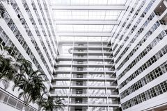 Big white office building blue sky palm construction many high tech Den Haag Hague inside within indoors modern neoteric new palm. Modern high-tech design of Royalty Free Stock Photography