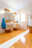 Big white and orange bathroom Royalty Free Stock Photography