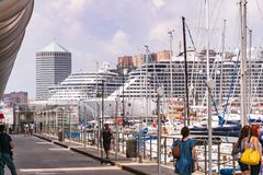 Passenger ships, ferries and yachts in the port - Porto Antico in Genoa, Liguria, Italy, Europa. royalty free stock photography