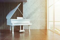White piano in a concrete and wooden room toned Royalty Free Stock Photography
