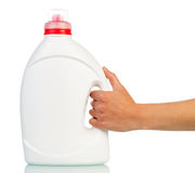 Big white plastic bottle in hand Royalty Free Stock Photos