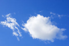 Big white puffy cumulus cloud on blue sky Stock Photo