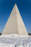 Big white pyramid on a cold snow. And blue sky stock images