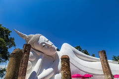 Big white reclining buddha statue in thai temple Royalty Free Stock Photography