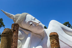 Big white reclining buddha statue in thai temple Stock Image