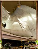 Big white reclining buddha statue on thai temple. Royalty Free Stock Images