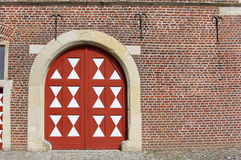 Big white-red door in the old stoned wall Royalty Free Stock Photos
