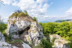Big white rock on hill, Palava Czech republic, forest hill and blue sky Royalty Free Stock Image