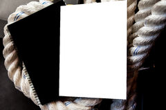 Big white rope and  magazine Royalty Free Stock Image