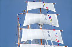Big white sail raised. Over blue clear sky Royalty Free Stock Images