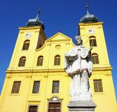 Monument of St. John of Nepomuk in front of the church bell tower of Saint Michael Archangel in the Croatian town Osijek stock images