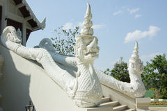 Big white snake statue and handrail of a temple in Thailand Royalty Free Stock Images