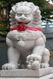 Big white stone lion in Chinese temple. Royalty Free Stock Photos