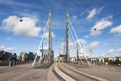 Big white suspension bridge with tram rails Stock Image