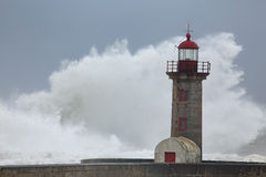 Big white wave over old lighthouse Royalty Free Stock Image