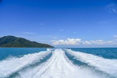 Big white wave and water splash from ferry boat sailing to Island. royalty free stock image
