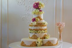 Big white wedding cake with flowers and ornaments Royalty Free Stock Photos