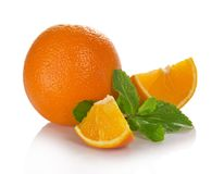 Big whole orange, slices and the mint Stock Photos