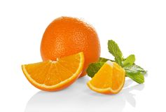 Big whole orange, slices of orange and the mint Royalty Free Stock Photos