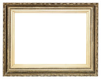 Big wide golden ancient wooden picture frame. With cut out canvas isolated on white background Royalty Free Stock Photo