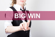 Big win written on virtual screen. technology, internet and networking concept. woman in a black business shirt presses Royalty Free Stock Photo