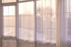 Big window. Bright interior. Transparent curtains. Light background. Light design Royalty Free Stock Photo