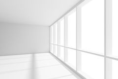 Big window in empty white room with sunlight. Business architecture white colorless office room interior - big window in empty white business office room with Royalty Free Stock Image