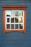 Big window in steelblue wooden wall Royalty Free Stock Image