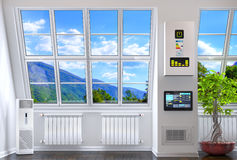 Big windows in the room with heating Stock Photo