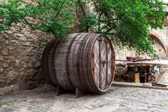 Big wine barrel on the street Royalty Free Stock Photo