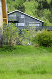 Winter House with a Bike on the Front Garden Royalty Free Stock Photography