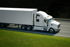 Big withe semi truck on highway Stock Photo