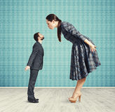 Big woman kissing small man Royalty Free Stock Photo