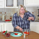 Big woman in kitchen Stock Image