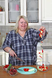 Big woman in kitchen Royalty Free Stock Photography