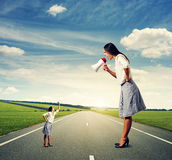 Big woman with megaphone and small woman Stock Images