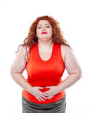 The big woman with red lipstick and large abdominal pain, bad mood Stock Photo